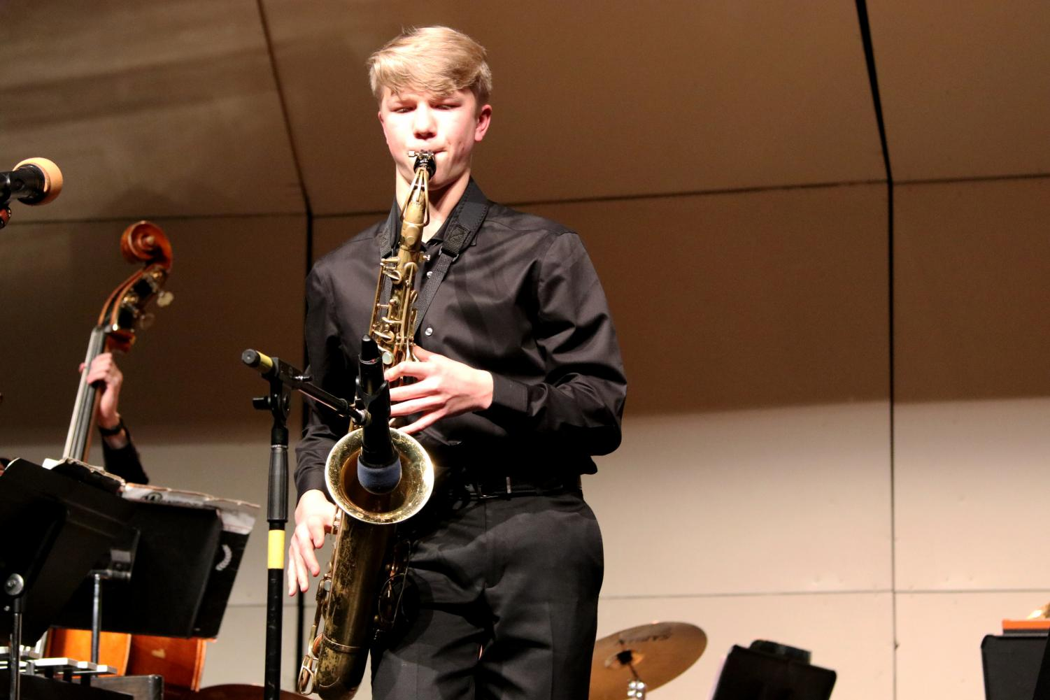 Saxophonist+Aaron+Rutherford+lets+loose+an+improved+solo+during+the+first+piece.