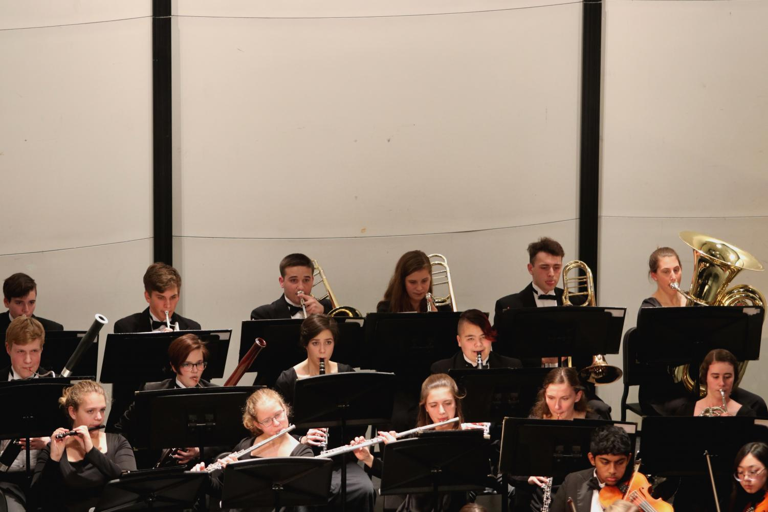 Members+of+the+Wind+Ensemble+join+the+orchestra+in+their+last+song.