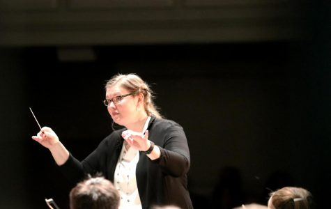 Mrs. Stucky Conducts both members of the Wind Ensemble and the Orchestra during the last song.