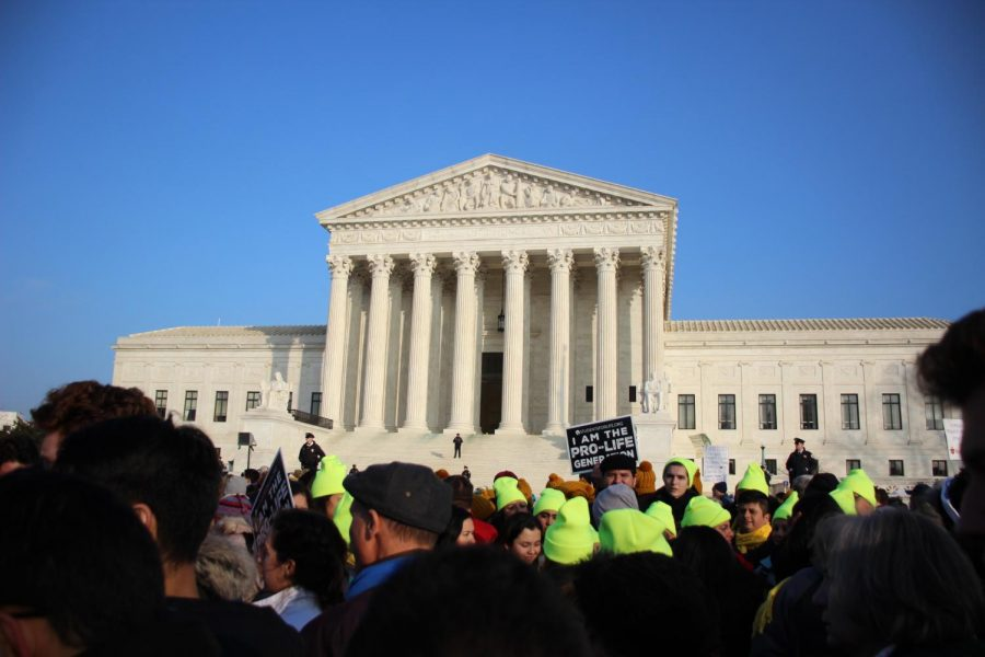 Marchers gather around the Supreme Court building to listen to Silent No More speakers, who share stories about their past experiences with the abortion industry.