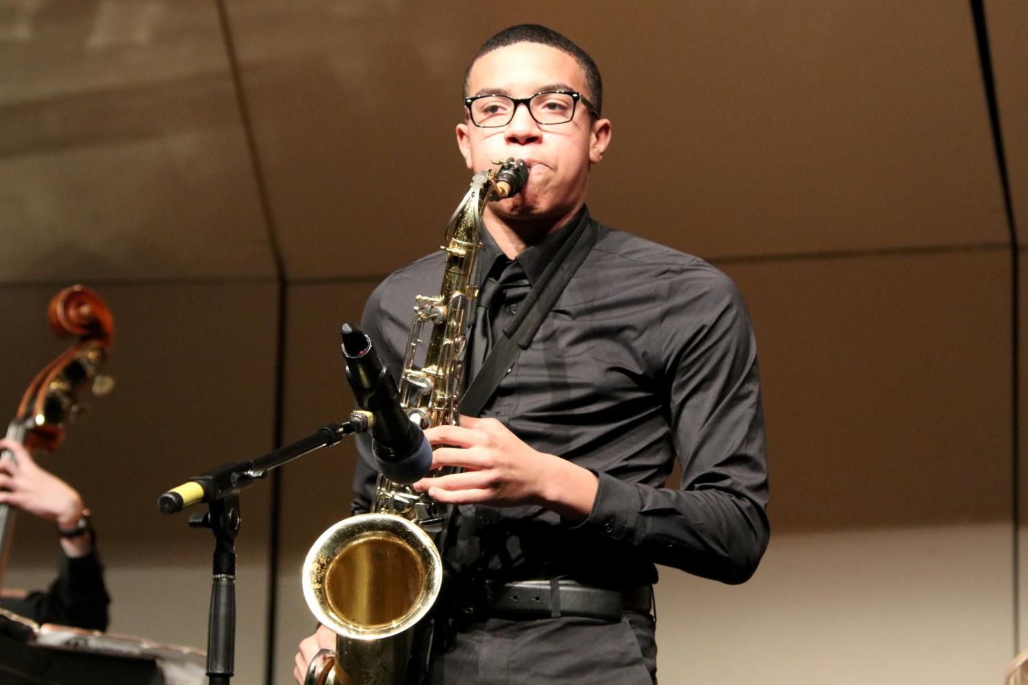 Saxophonist+Jayden+Freeman+plays+the+tenor+sax+during+a+solo+in+the+second+piece.