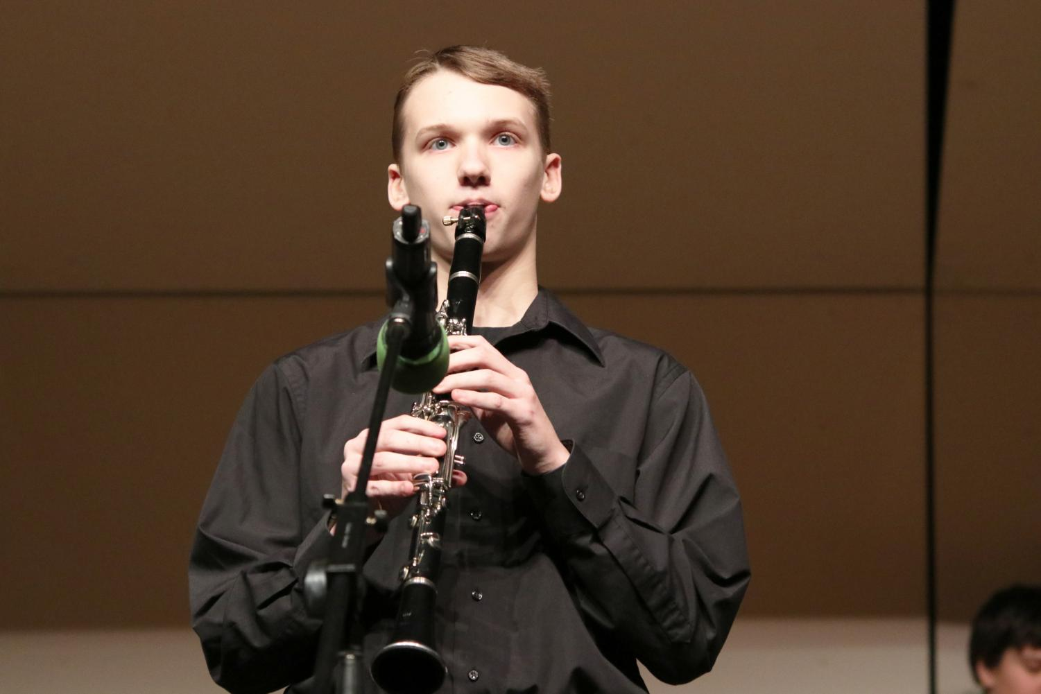 Clarinetist+Noah+Hartwig+prepares+himself+for+a+solo+during+the+first+piece.