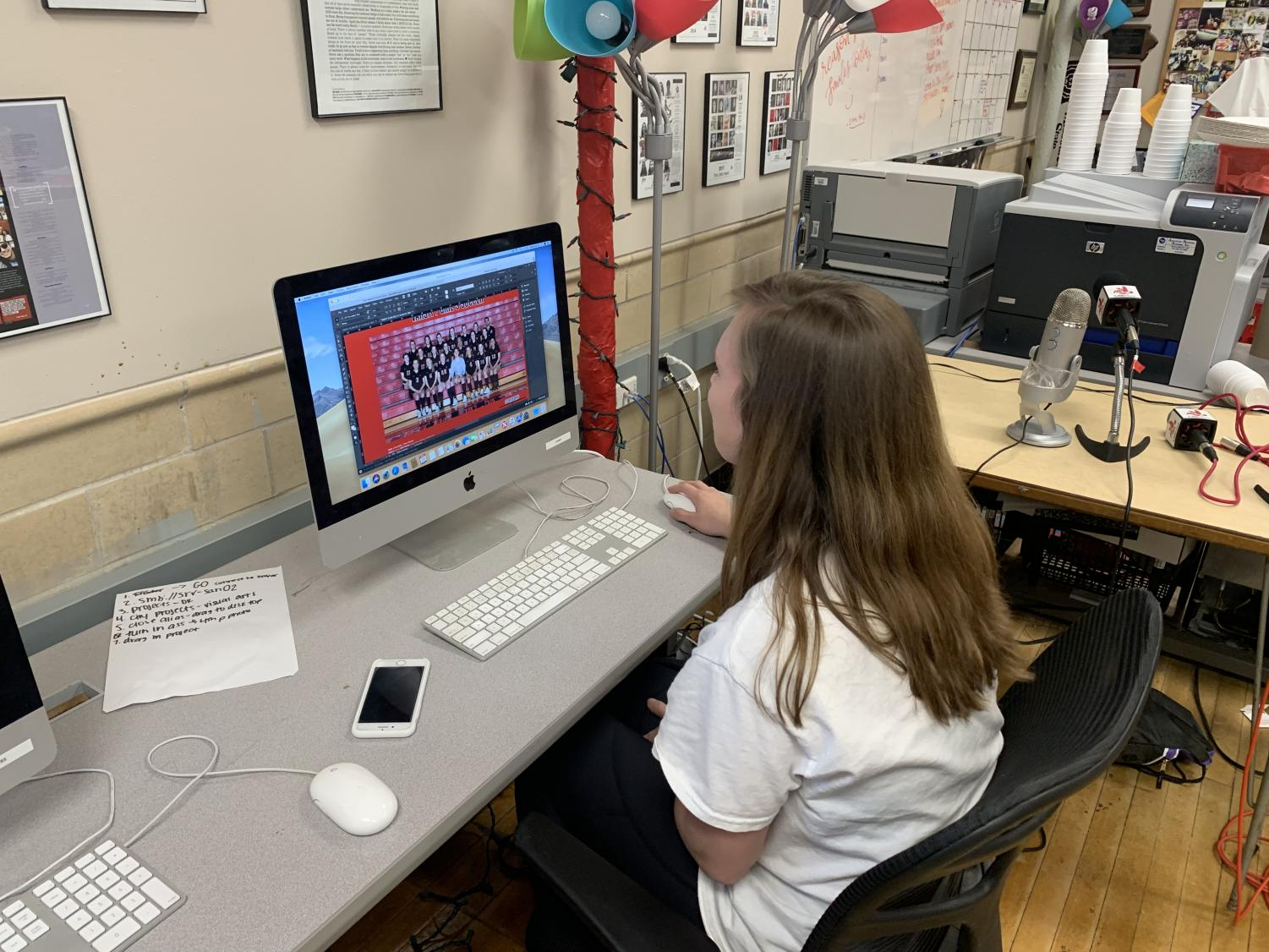 Eva Bailey works on the final pages of the 2018-19 Red and White yearbook.