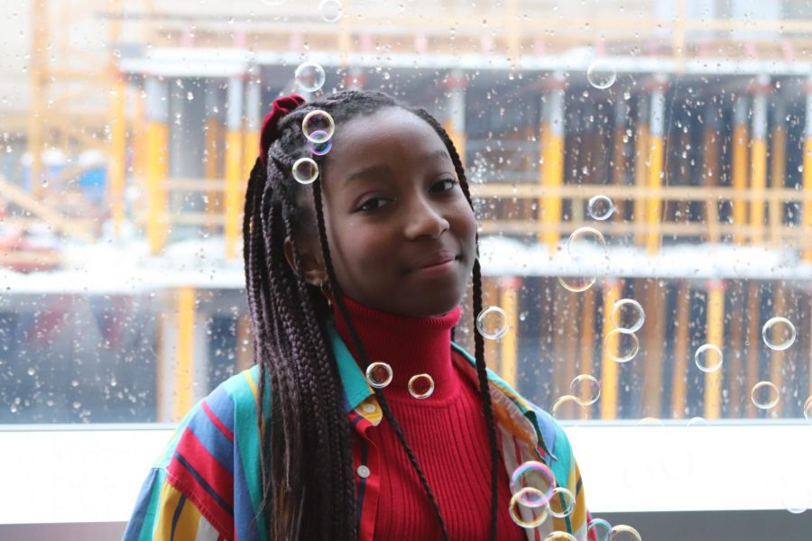 Faith+Odhiambo+%2722+poses+with+bubbles+highlighting+the+bright+colors+of+her+jacket.
