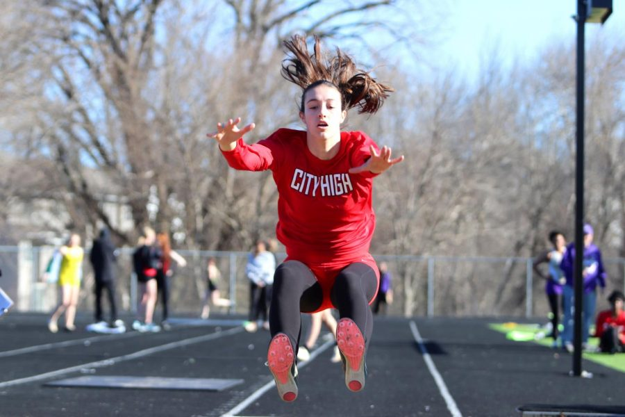 Caroline Schaeckenbach '20 long jumps at a meet at Iowa City West in March of 2019.