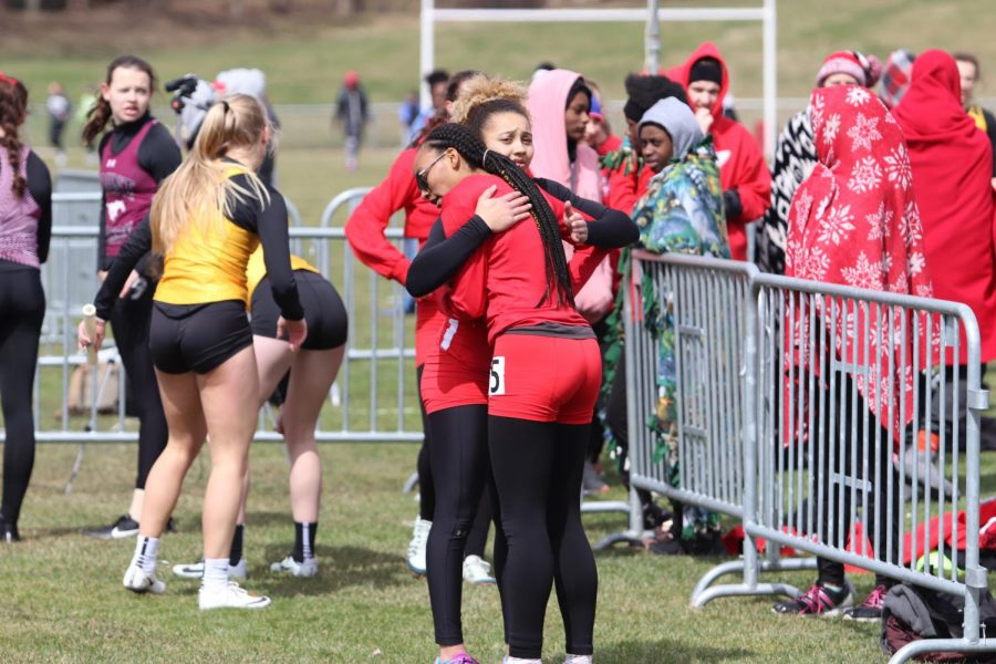 Ayana Lindsey '21 hugs Cece Kelly-Harvey '21 after the varsity 4x800.