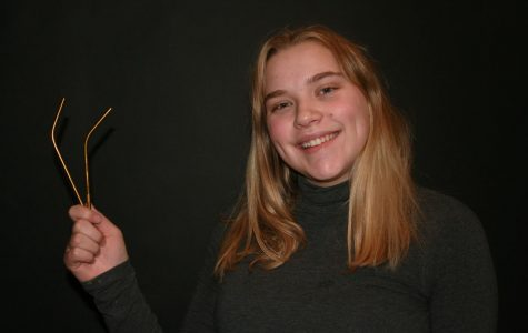 Claire Green '19 holds her metal straws