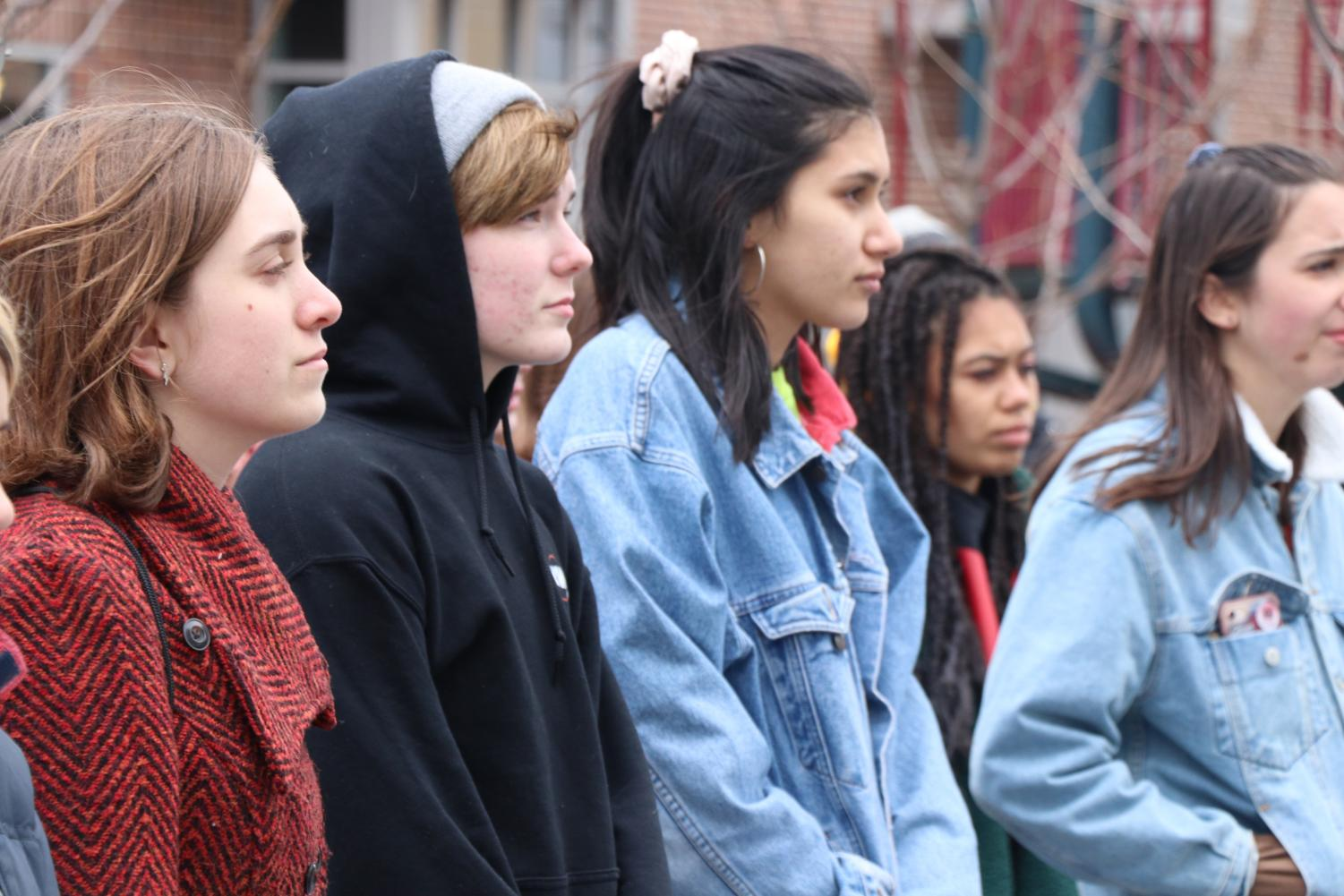 City students listening to speeches after march.