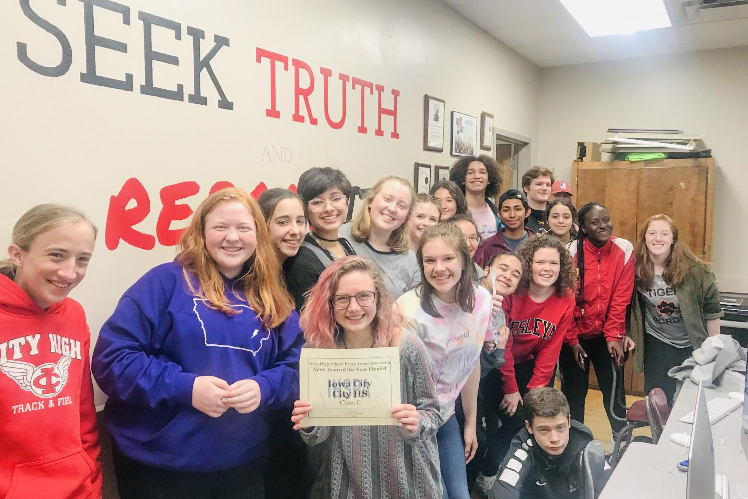 Little Hawk reporters hold their IHSPA News Team of the Year Finalist Award