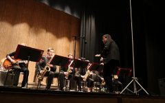 Director Aaron Ottmar conducting during their performance in Stephens Auditorium