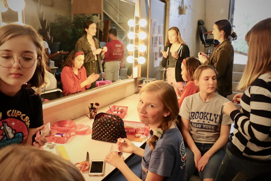 Frances Bottorff '22 does her makeup before the show.