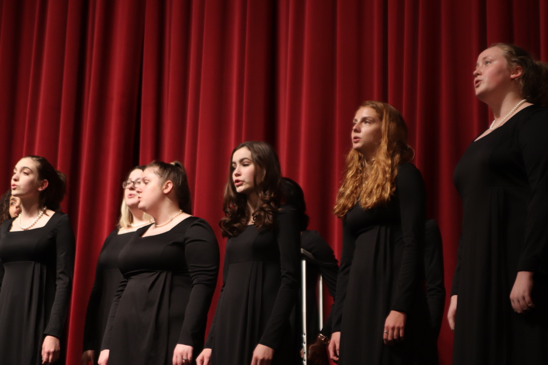 A group of students sing for their performance in the competition.