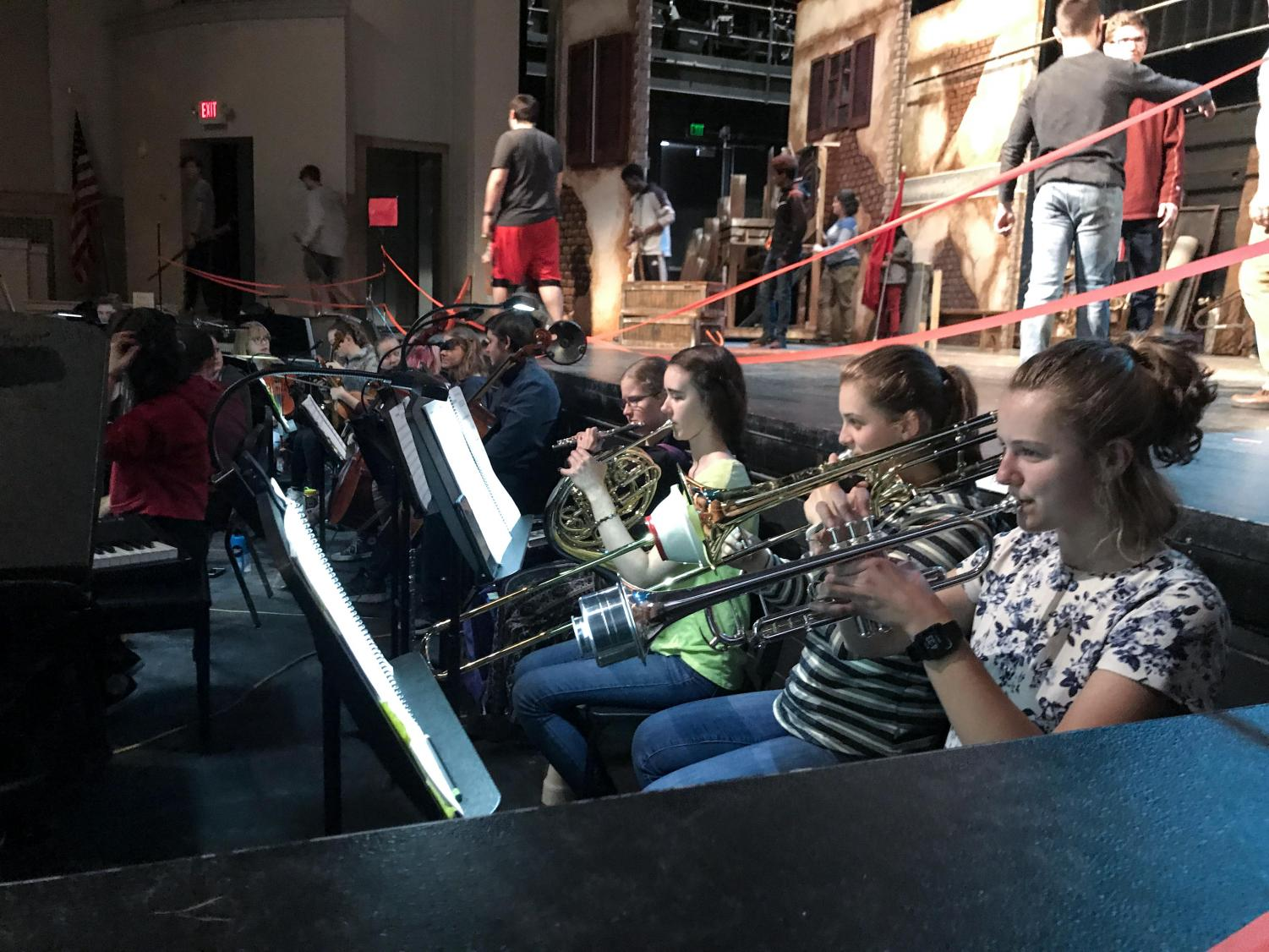 Members of pit orchestra play during rehearsal.