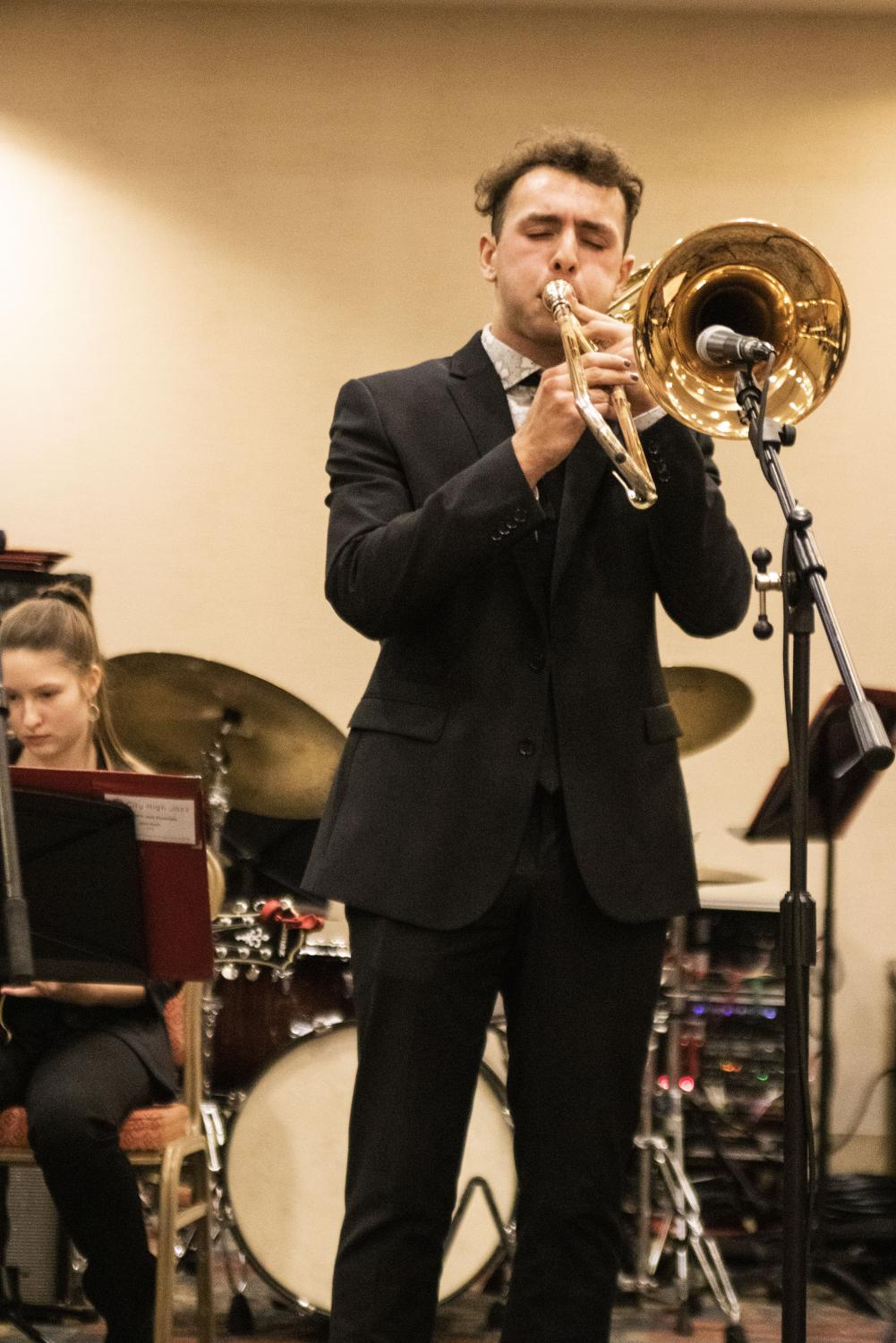 Ryan+Carter+%2720+soloing+on+Bass+Trombone.+Carter+was+one+of+three+city+high+students+who+also+participate+in+All+State+Jazz