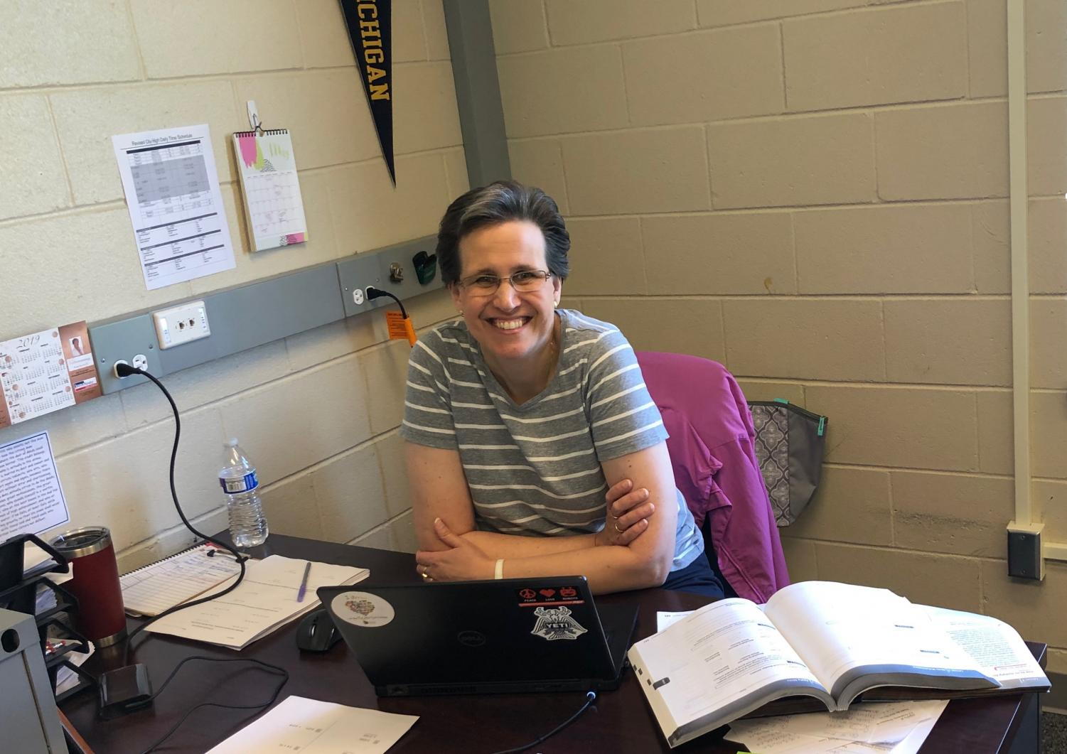 Mrs. Mons poses in her classroom