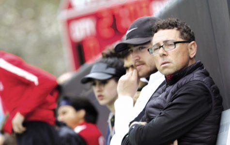 Boys soccer coach Jose Fajardo watches the boys team on the turf field at City High.