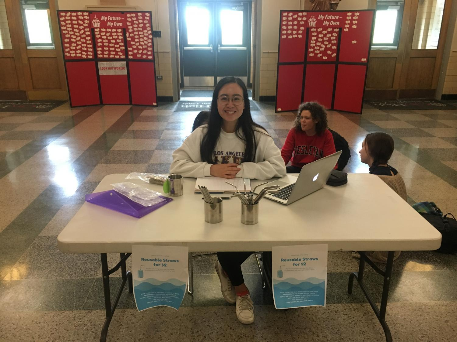 Michelle Tran-Duong '19 selling reusable straws in the main foyer.