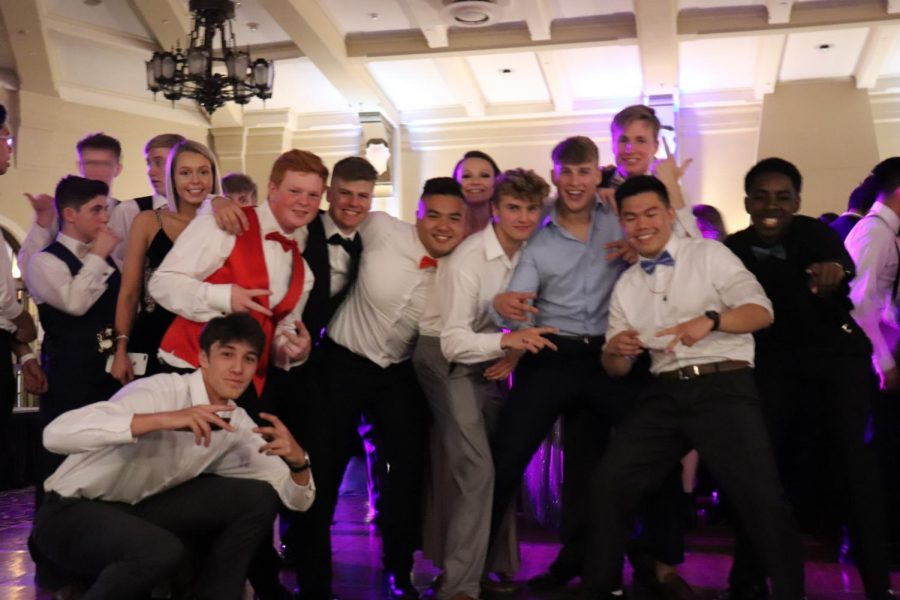 A+group+of+senior+boys+pose+for+a+photo+at+prom.
