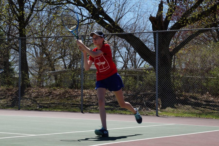 Evelyn Wolfe 19 strikes the ball on her home court
