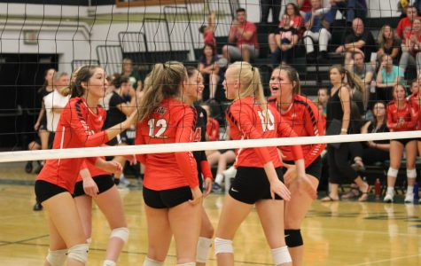 City High Volleyball celebrates after defeating West in the Battle for the Spike on August 27, 2019.