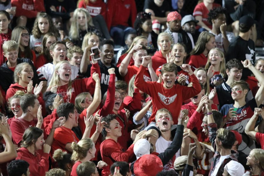 The+City+High+student+section+had+a+red+out+theme+against+Liberty.