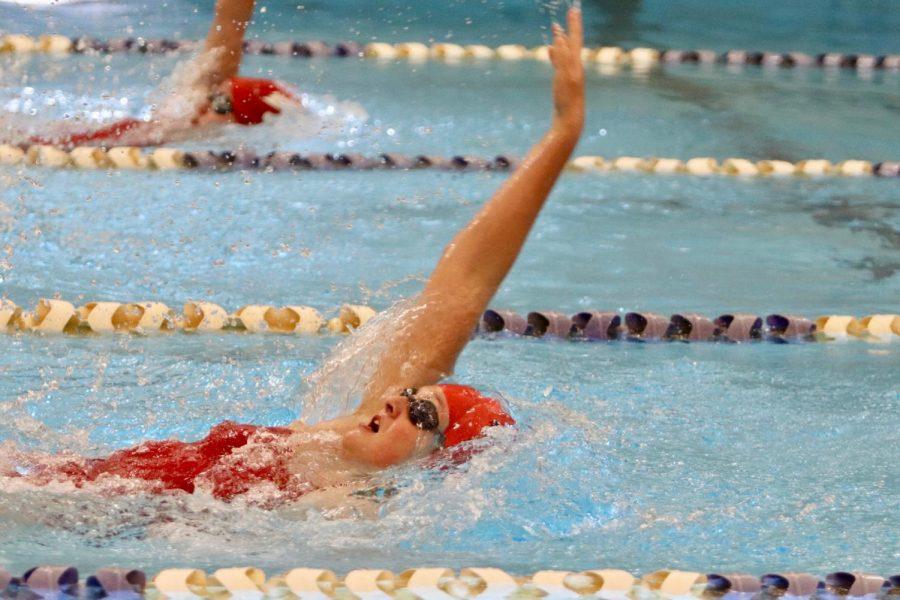 Trinity Sadecky '20 swimming the 100 backstroke.
