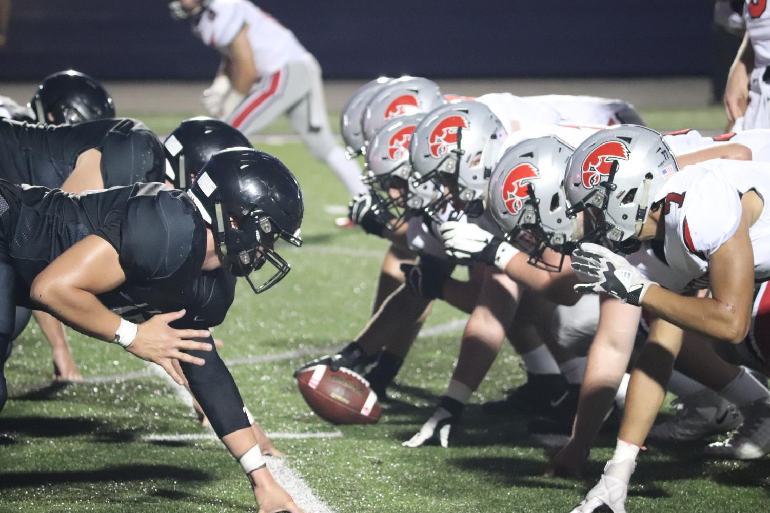 Liberty High vs. City High  in the first football game of the season.
