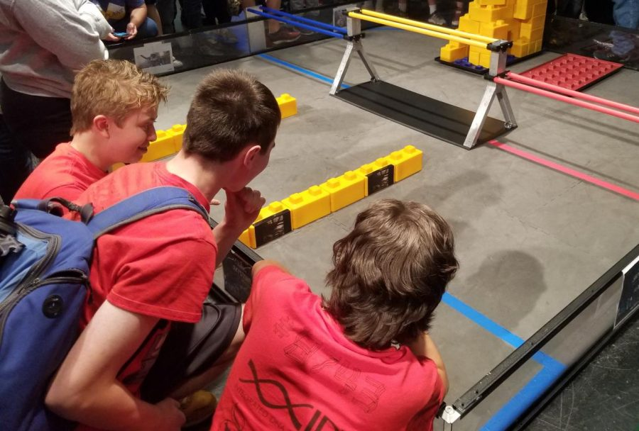 Robotics members observe a preview of the 2019-2020 competition theme.