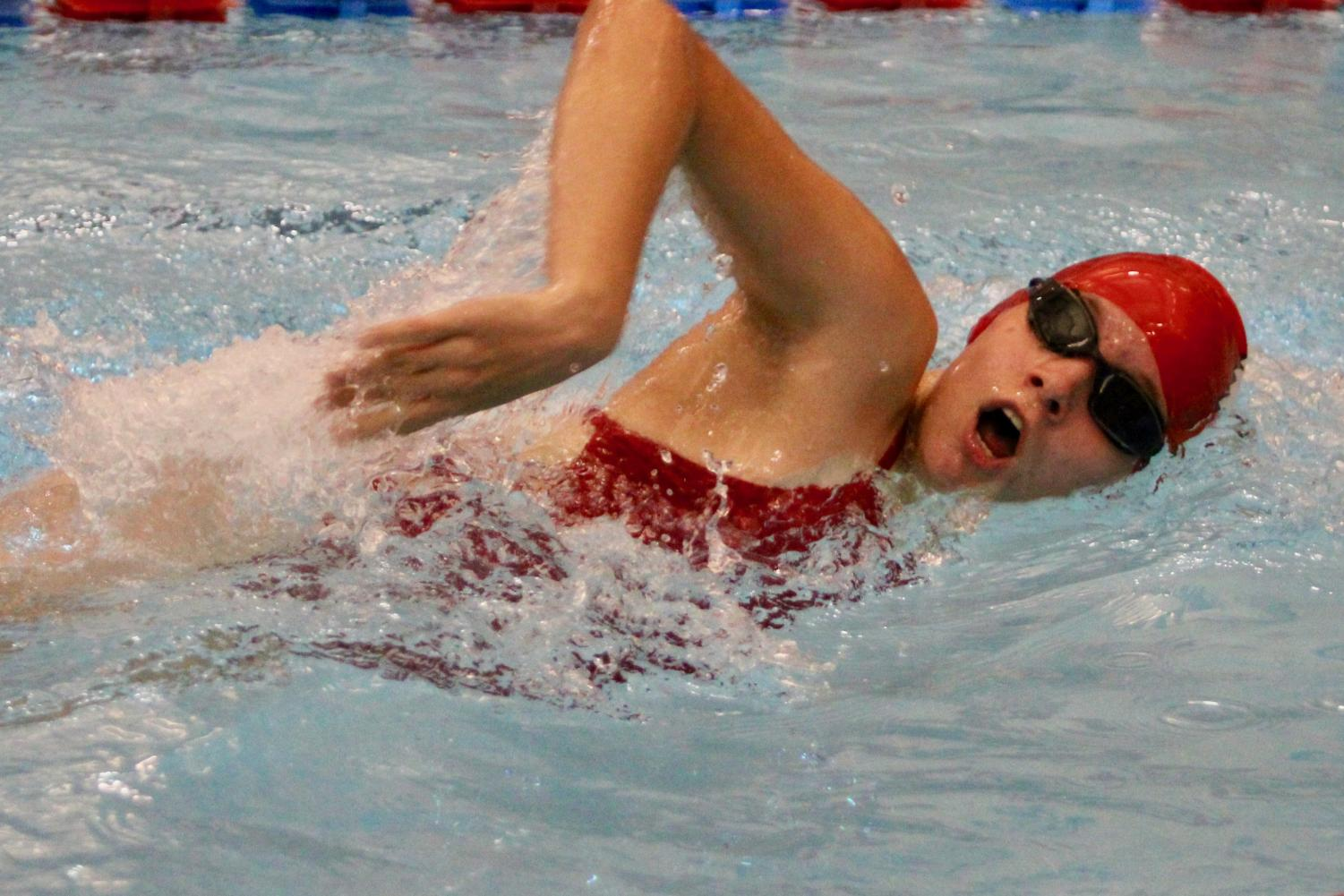 Abbie Fredericks '23 swims  freestyle against Dubuque Senior on October 8, 2019.