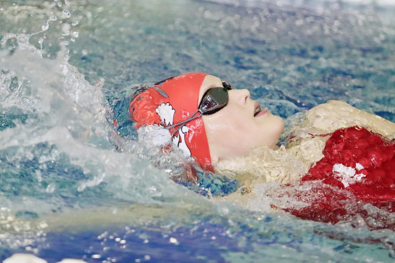 Isabelle Polfliet '23 swims backstroke in the 200 medley relay.