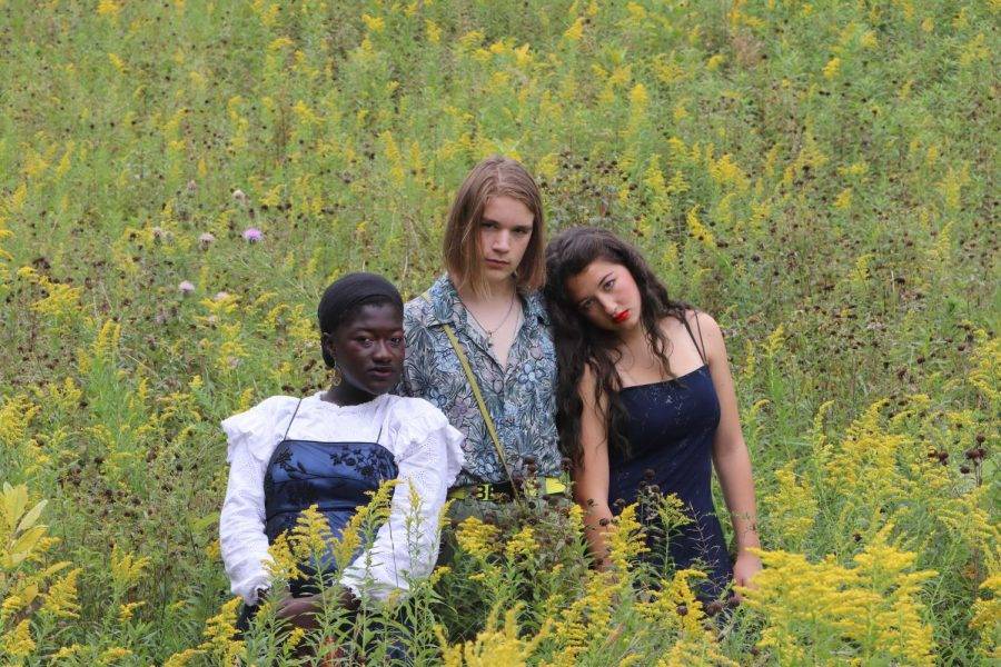Though dressed in formal attire, Kate Wolfe '21, Garret Forbes '20, and Mariam Keita '20 brave the burrs and hike through the prairie.