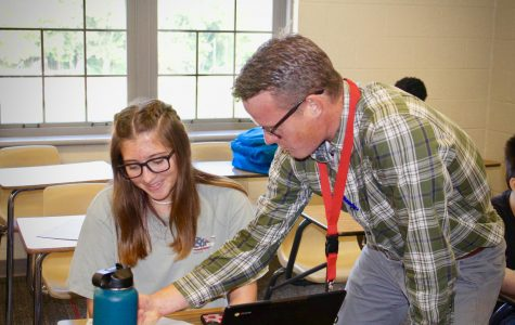Mr. Enyart helps Gabby Clark '23 with her homework.