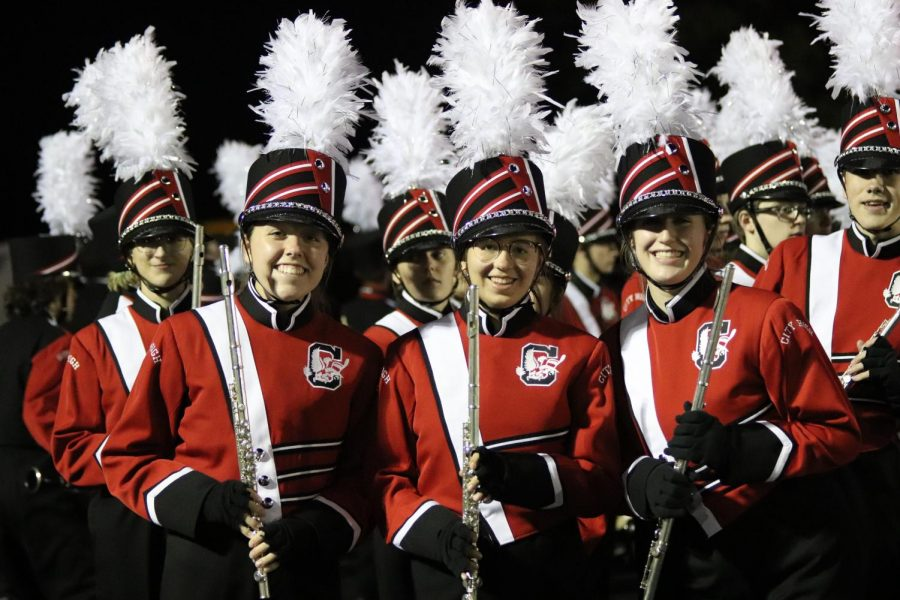 Band members pose before their halftime show.