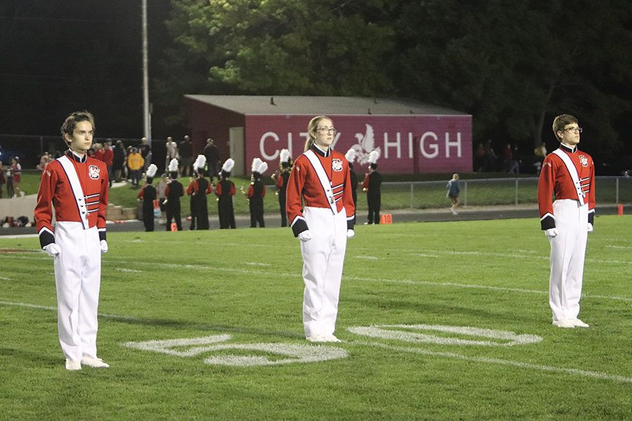 Drum Majors Joseph Bennett '20, Katherine Itrona '20, and Toby Epstein '21 Saluting the audience for the marching pre-game to start.