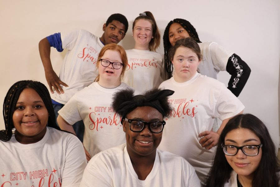 The Sparkle cheer team strikes a pose. The team is a place where students of all abilities can feel welcome.