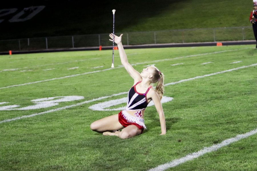 Josie Gillette '21 catches her baton while performing with the City High marching band.