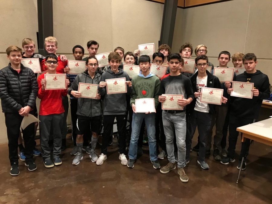 The+Boys+Cross+Country+team+freshman+pose+with+their+certificates+of+completing+a+year+of+cross+country.