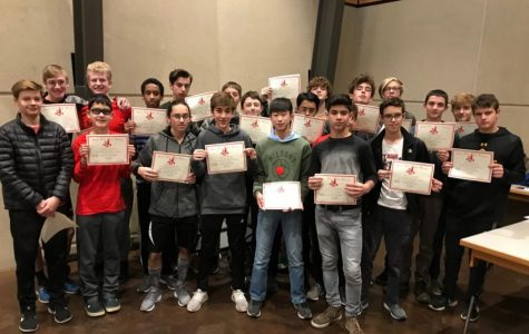 The Boys Cross Country team freshman pose with their certificates of completing a year of cross country.