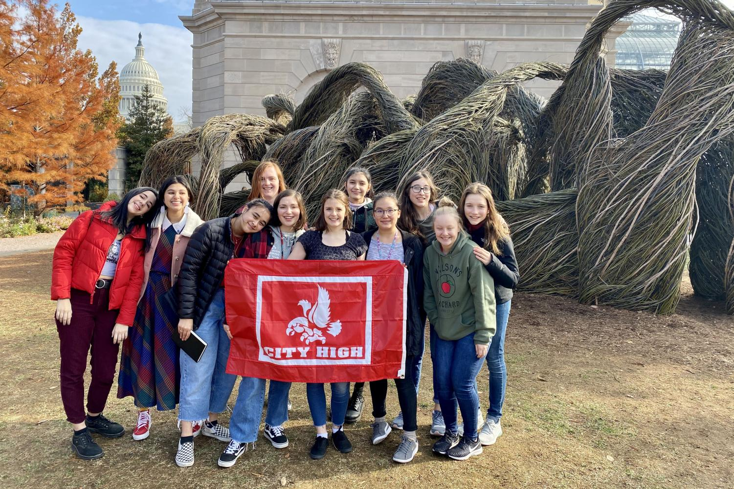 Little Hawk Journalists stand below the Capitol building at the National Botanical Gardens.  Representative Loebsack's assistant guided them on their tour of the Capitol.