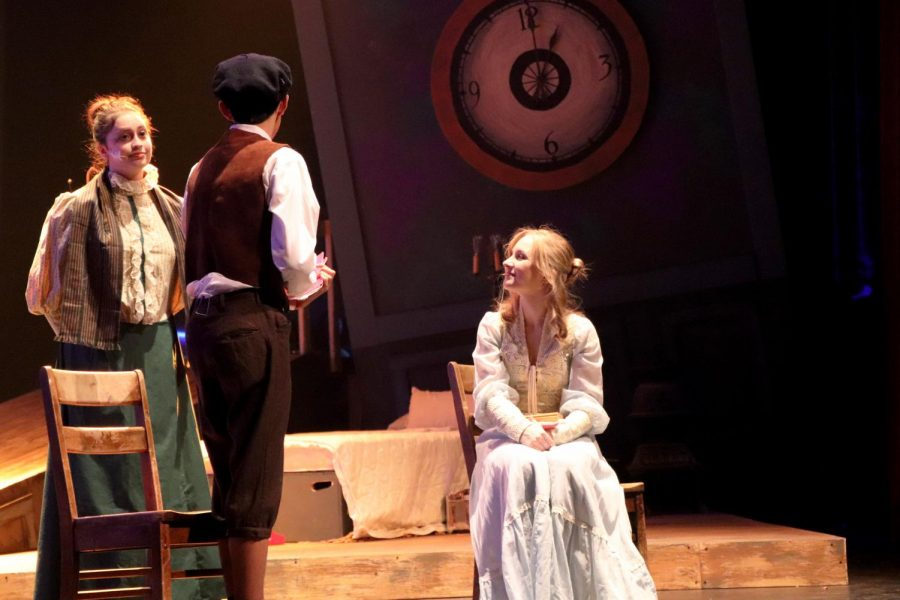 The schoolmaster played by Elise Laternier '20 tells siblings Ebenezer Scrooge, played by Whit Jury '23, and Fan Scrooge, played by Reese Hill '20, that Ebenezer is to work in a boot blacking factory in London.