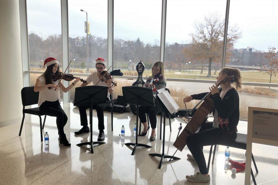 String Quartet of Kaya Zdan '20, Mark Krysan '20, Alex Marsh '20, and Daphne Knoop '20 play at Hancher event.