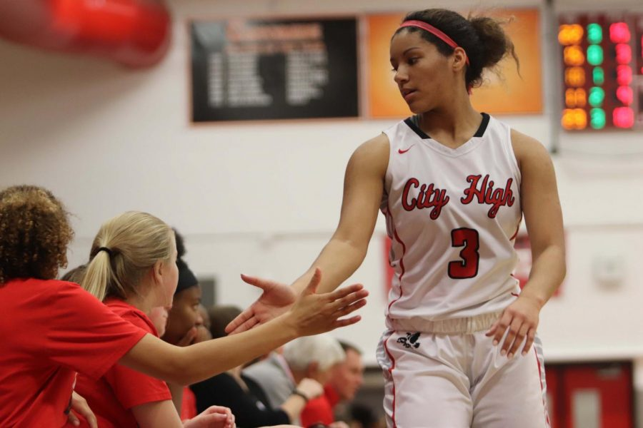Rose Nkumu '20 high fives her teammates during City's win against Cedar Rapids Kennedy.