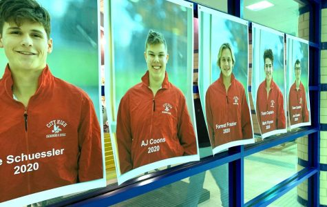 The seniors' pictures hang in the window at Mercer Park Aquatic Center.
