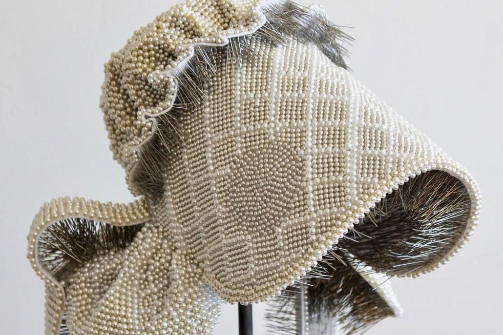 Angela Ellsworth's beaded bonnet art piece.