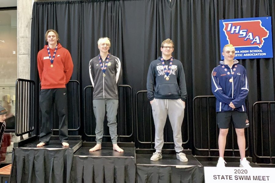 Forrest Frazier '20 stands in first place, holding the new 100 breaststroke state record.