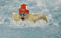 John Weigel '23 swims the 100 butterfly at Linn-Mar, finishing with a season best time of 1:02.03.