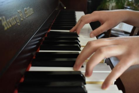 Callista Robertson '22 practices piano at her home.