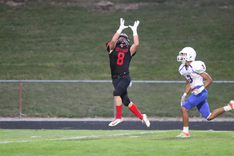 #8 Gable Mitchell jumps to catch the ball.