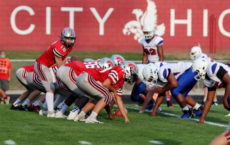 The City High Sophomore Football team lines up against the Davenport Central Blue Devils.
