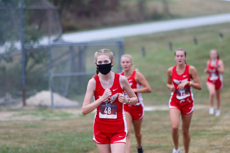 Greta Boerner '23 in the first mile in the girls JV race at Hillcrest Academy.
